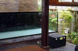 Aquarium chiller besides a fish tank